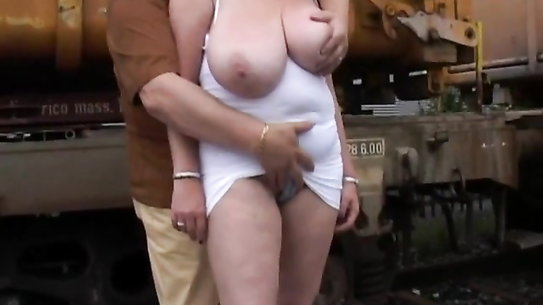 Chubby mature has her huge boobs groped by a stranger