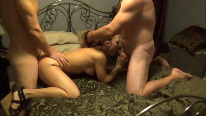 Busty GF pleasures two large cocks with fervor