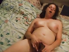 My wife with big naturals enjoys bating her sensitive clitoris
