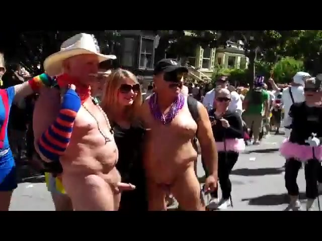 Two old exhibitionists take pictures with hot chicks while being naked