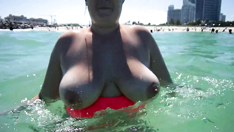 Chubby mommy gets recorded having her large tits out while swimming