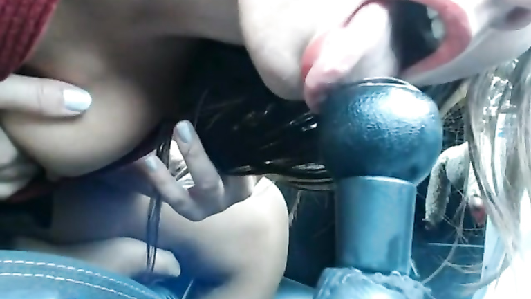 Brunette vixen sucks on a gear stick and plays with her cherry