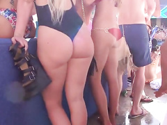 Mature lady wears a rather tight swimming suit