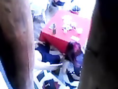 Amazing redhead gal rubs and kisses her friend's dick at a restaurant
