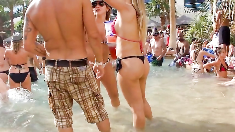Smoking hot blonde bombshell has some fun by the pool
