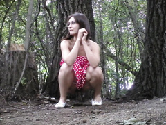 Cutie in a sexy red dress takes a piss in the woods