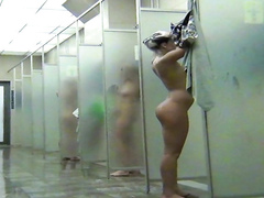 Young ladies enjoy washing their bodies in the public shower