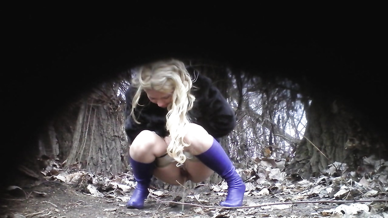 Slutty blonde in blue boots pees in the middle of the public park