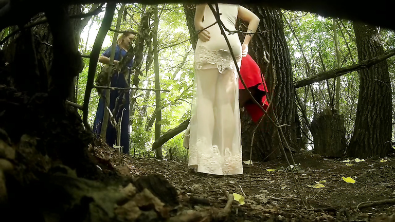 Classy bridesmaids take a piss together in the woods