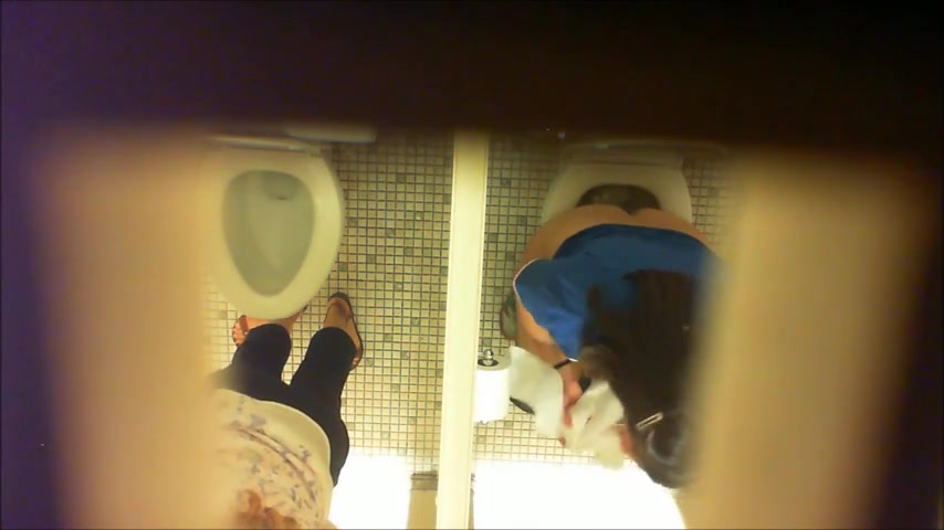 Females get filmed while urinating in the ladies room