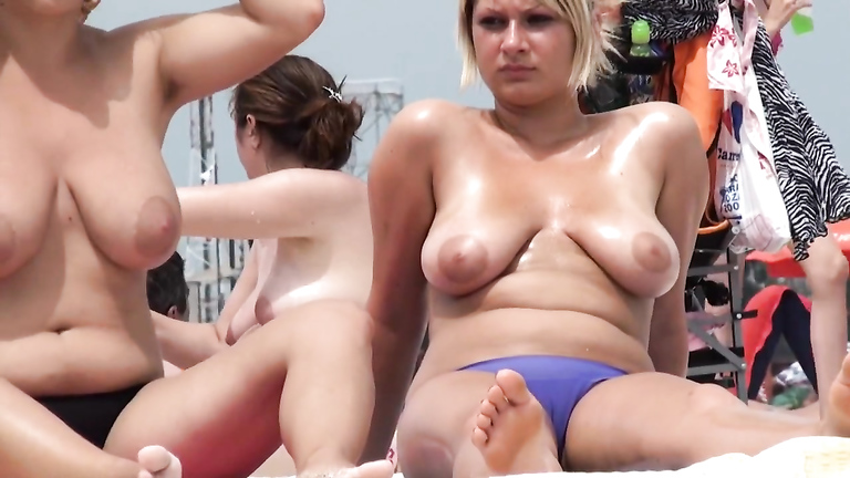 Two sisters enjoy the sun with their big milky tits out