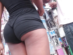 Bootylicious ebony goddess is wearing rather tight shorts