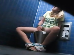 Cute kinky girl caught masturbating in the public toilet