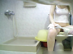 This girl is caught in the bathroom on hidden cam