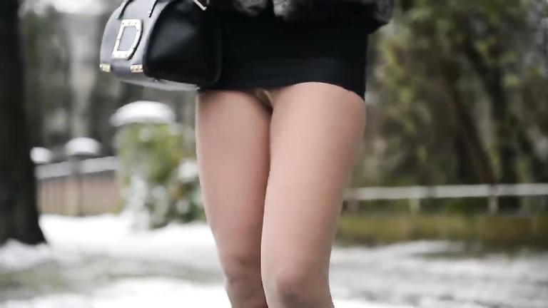 High heels and a miniskirt accentuate the sexy legs of a street hooker