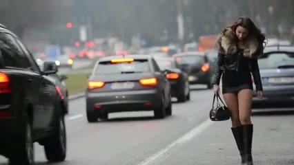 Street hooker wear a fur jacket and a mini skirt