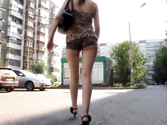 Big round buttocks jiggle while a curvy Russian babe walks down the street