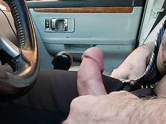Redhead prostitute watches an exhibitionist playing with himself in the car