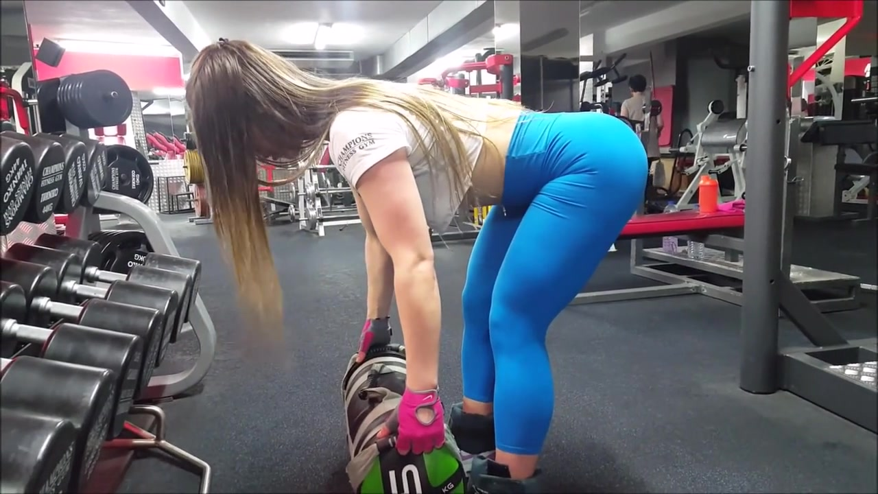My fitness trainer's buttocks bounce as she works out