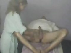Unfortunate masseuse has to work around a fully-erect dick