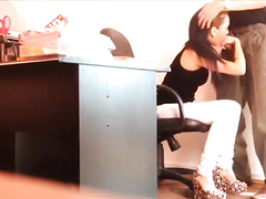 Hidden cam films a slim secretary blowing a big boss's cock