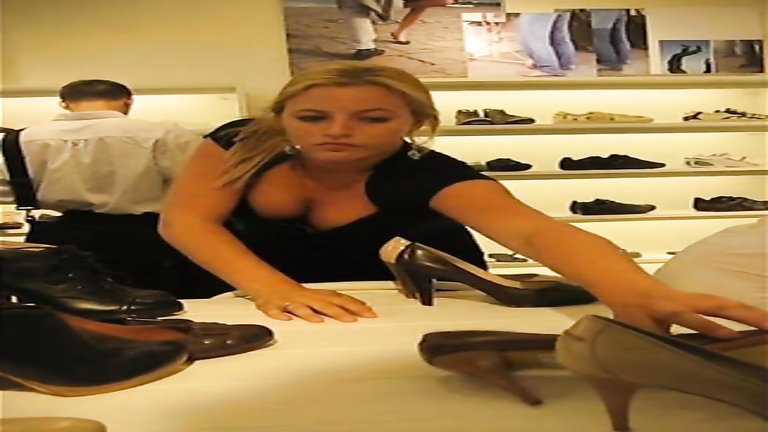 Luscious shop worker with big boob rearranges shoes