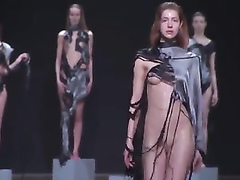 Fashion models drop balloons filled with water on the catwalk