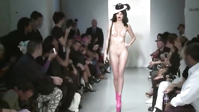 Two stunning models show off hats, bags and boots in the nude