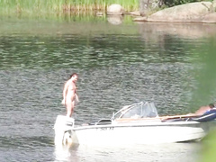 Nudist couple has fun in the middle of a beautiful lake