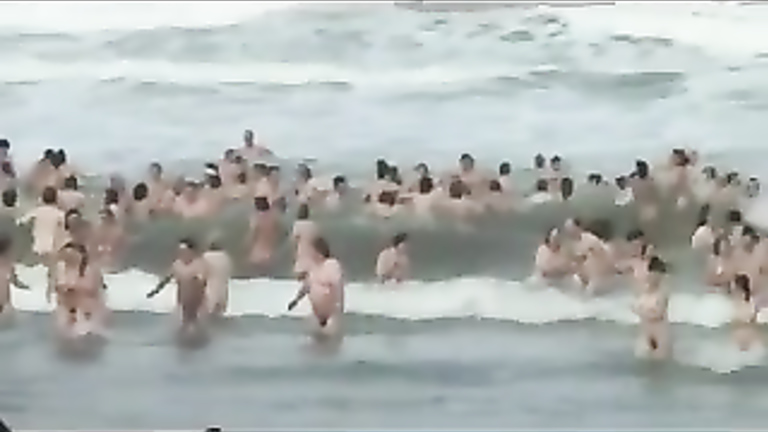 Bunch of people go skinny dipping in order to set a new record