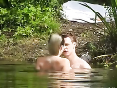 Short-haired GF jumps on a dick while swimming in the lake