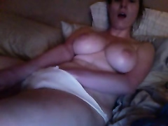 Big-boobed sweetheart plays with herself in the bedroom