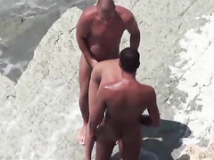 Nudist women and men have sex in the scorching sun