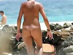 Charming nudist milf gets spied on from a secluded spot
