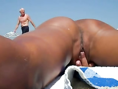 Pussy playing with an attractive nudist woman