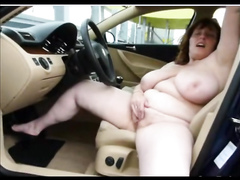 Fat mature with huge tits fingering in the car