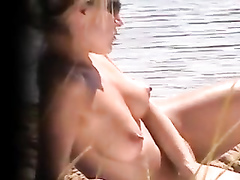 Naked blonde has her puffy nipples filmed in secret while she is enjoying the sun