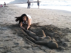 Sexy young brunette gets jizzed at the beach by stranger