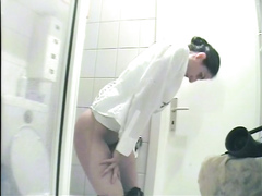 Office colleague filmed while peeing and farting