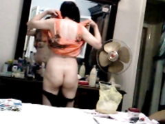 Aunt gets filmed when changing her panties and posing