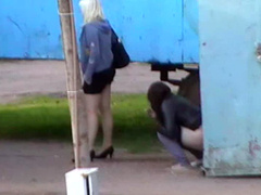 Two Poland prostitutes urinate on the street and zip up