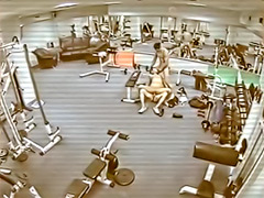 Security camera films a threesome in the gym