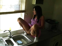 Playful babe pisses in the sink like a bad girl