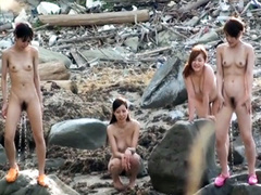Japanese babes piss on the rocks outdoors