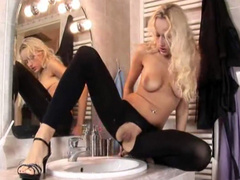 Blonde in ripped tights pees into the sink