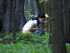 Girl pees in the woods as I film her