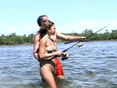 Fishing fans have sex in shallow river water