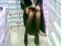 Lady in black stockings tries on high heels