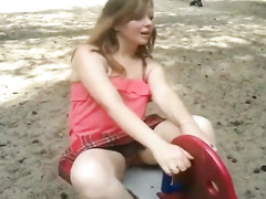 Cutie in the park flashes a pussy up her skirt