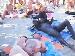 Nudist orgy at the beach with an audience